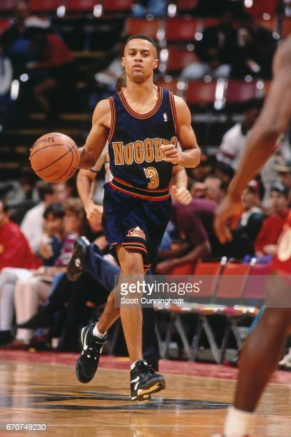 Chris Jackson of the Denver Nuggets dribbles against the Atlanta Hawks during a game played circa 1990 at the Omni in Atlanta Georgia NOTE TO USER...