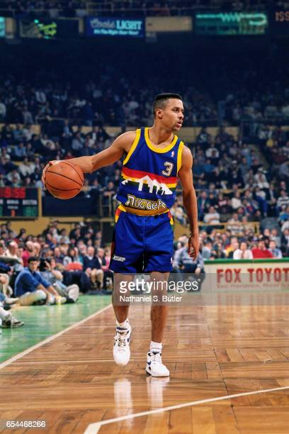 Chris Jackson of the Denver Nuggets dribbles against the Boston Celtics circa 1993 at the Boston Garden in Boston Massachussetts NOTE TO USER User...