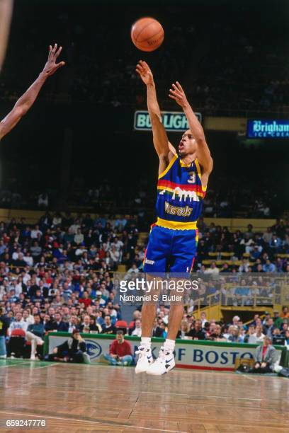 Chris Jackson of the Denver Nuggets shoots against the Boston Celtics circa 1993 at the Boston Garden in Boston Massachussetts NOTE TO USER User...
