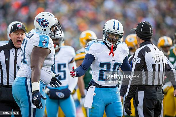 Chris Johnson and Fernando Velasco of the Tennessee Titans make a point to Ron Marinucci Field Judge during the game with the Green Bay Packers at...