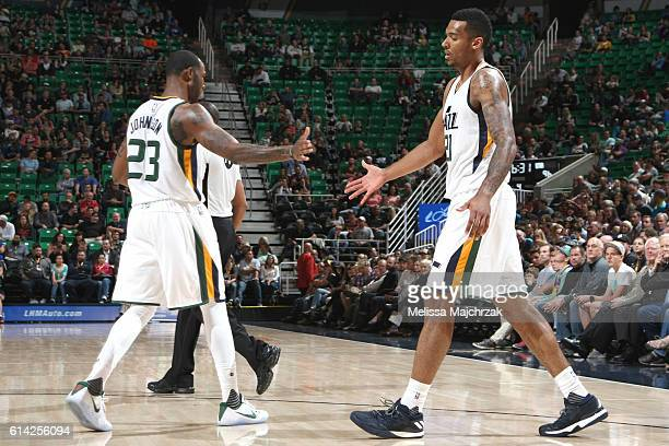 Chris Johnson and Joel Bolomboy of the Utah Jazz highfive during a preseason game against the Phoenix Suns on October 12 2016 at Vivint Smart Home...