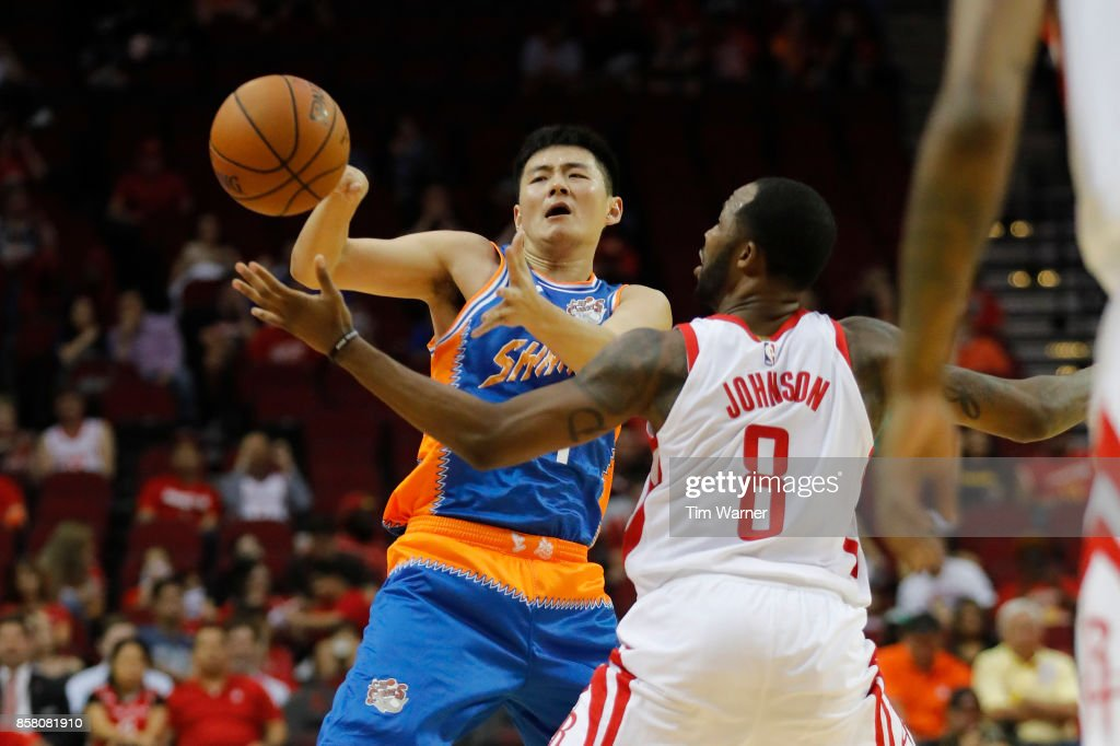 Chris Johnson #8 of Houston Rockets steals the ball from Shi Yuchen #47 of Shanghai Sharks in the second half at Toyota Center on October 5, 2017 in Houston, Texas.