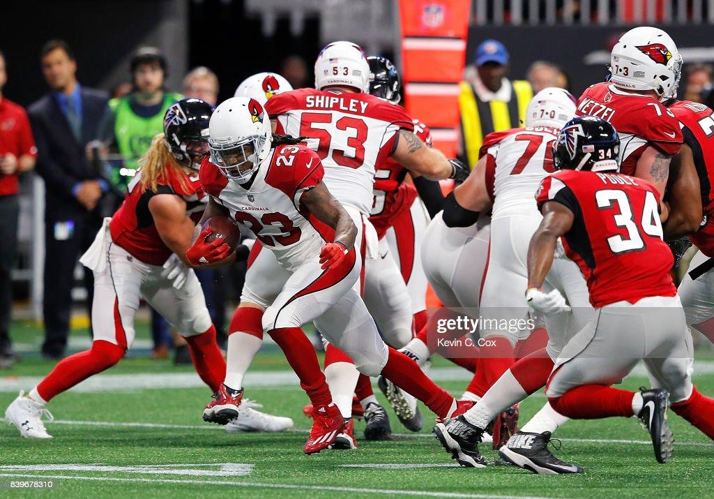 Chris Johnson #23 of the Arizona Cardinals rushes against the Atlanta Falcons at Mercedes-Benz Stadium on August 26, 2017 in Atlanta, Georgia.