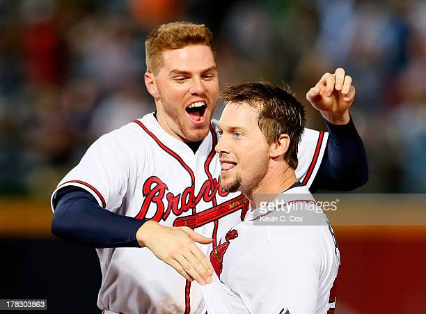 Chris Johnson of the Atlanta Braves celebrates with Freddie Freeman after hitting a walkoff RBI single in the ninth inning against the Cleveland...