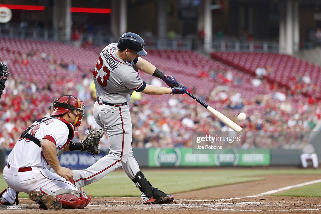 Chris Johnson #23 of the Atlanta Braves drives in a run with a double in the third inning of the game against the Cincinnati Reds at Great American Ball Park on August 21, 2014 in Cincinnati, Ohio.
