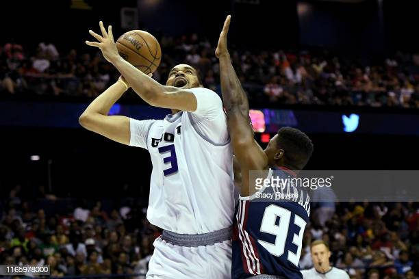 Chris Johnson of the Ghost Ballers attempts a shot while being guarded by Yakhouba Diawara of Tri-State in the first half during week seven of the...