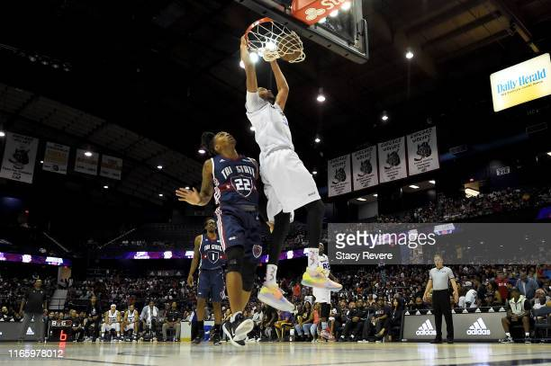 Chris Johnson of the Ghost Ballers dunks the ball past Robert Hite of Tri-State in the second half during week seven of the BIG3 three on three...