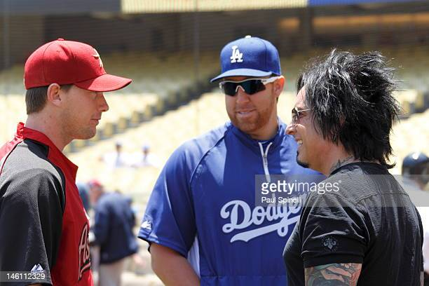 Chris Johnson of the Houston Astros and Aaron Harang of the Los Angeles Dodgers share some pregame laughs with Nikki Sixx founder and bassist of the...