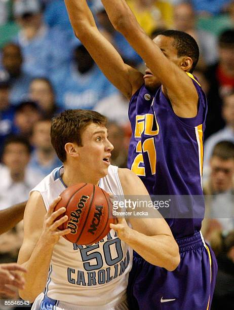 Chris Johnson of the Louisiana State University Tigers defends against Tyler Hansbrough of the North Carolina Tar Heels during the second round of...