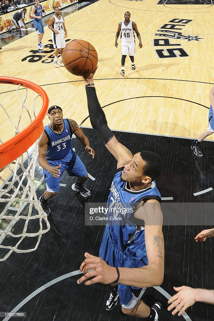 Chris Johnson #20 of the Minnesota Timberwolves rises for a dunk against the San Antonio Spurs during a game played on April 17, 2013 at the AT&T Center in San Antonio, Texas.
