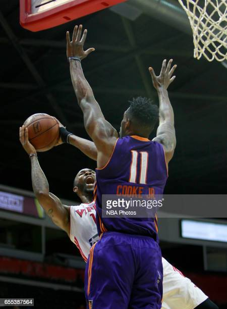 Chris Johnson of the Rio Grande Valley Vipers shoots the ball on Derek Cooke Jr #11 of the Northern Arizona Suns at the State Farm Arena March 19...