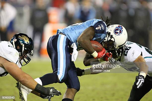 Chris Johnson of the Tennessee Titans hits Brian Russell of the Jacksonville Jaguars during their game at LP Field on November 1 2009 in Nashville...