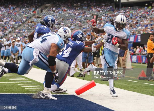 Chris Johnson of the Tennessee Titans is pushed out of bounds at the endzone by Terrell Thomas of the New York Giants at New Meadowlands Stadium on...