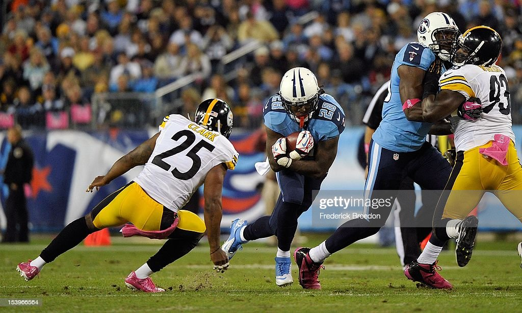 Chris Johnson #28 of the Tennessee Titans is tackled by Ryan Clark #25 of the Pittsburgh Steelers at LP Field on October 11, 2012 in Nashville, Tennessee.