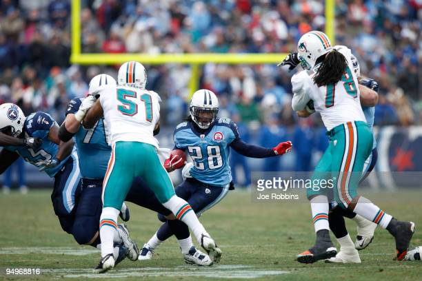 Chris Johnson of the Tennessee Titans looks for running room during first half action against the Miami Dolphins at LP Field on December 20 2009 in...