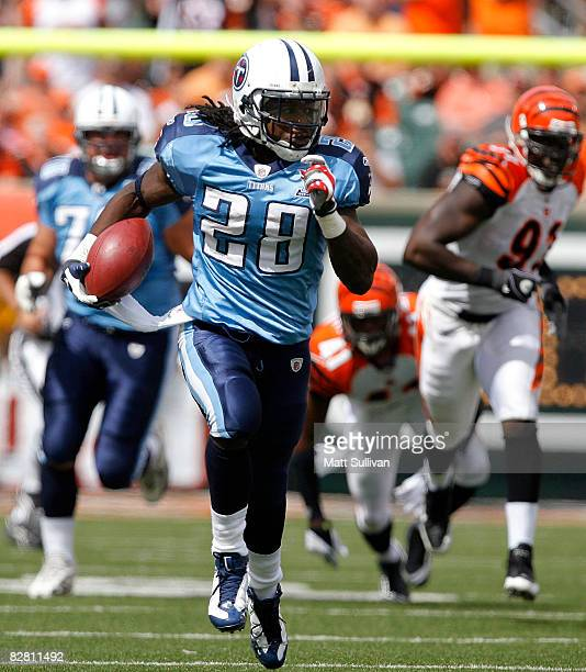 Chris Johnson of the Tennessee Titans runs the ball against the Cincinnati Bengals during the second quarter of their NFL game September 14 2008 at...