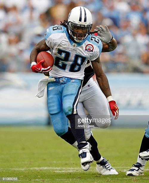 Chris Johnson of the Tennessee Titans runs with the ball during the NFL game against the Houston Texans at LP Field on September 20 2009 in Nashville...