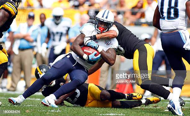 Chris Johnson of the Tennessee Titans rushes against the Pittsburgh Steelers during the game on September 8 2013 at Heinz Field in Pittsburgh...