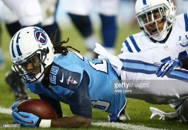 Chris Johnson of the Tennessee Titans scores a first quarter touchdown against the defense of Antoine Bethea of the Indianapolis Colts at LP Field on...