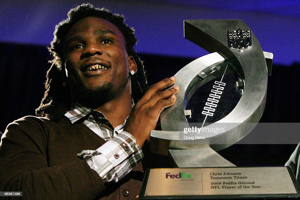 Chris Johnson #28 of the Tennessee Titans smiles with his award after being named the FedEx Ground NFL Player of the Year at a press conference held at the Fort Lauderdale Convention Center as part of media week for Super Bowl XLIV on February 3, 2010 in Fort Lauderdale, Florida.