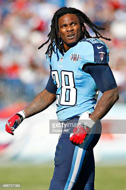 Chris Johnson of the Tennessee Titans watches a replay after his helmet is knocked off during a game against the Houston Texans at LP Field on...