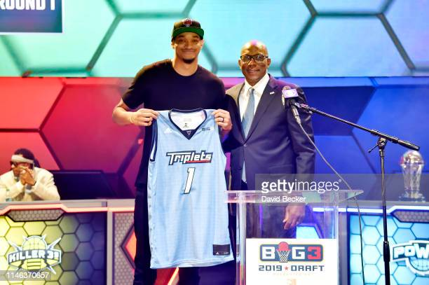 Chris Johnson poses with BIG3 Commissioner Clyde Drexler after being drafted at by the Triplets in the first round during the BIG3 Draft at the Luxor...