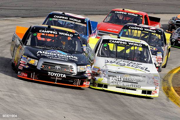 Chris Jones driver of the LCS Motorsports and Brian Scott driver of the Albertson's Toyota lead a group of trucks during the NASCAR Camping World...