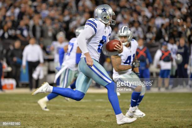 Chris Jones of the Dallas Cowboys runs on a fake punt for a first down against the Oakland Raiders during their NFL game at OaklandAlameda County...