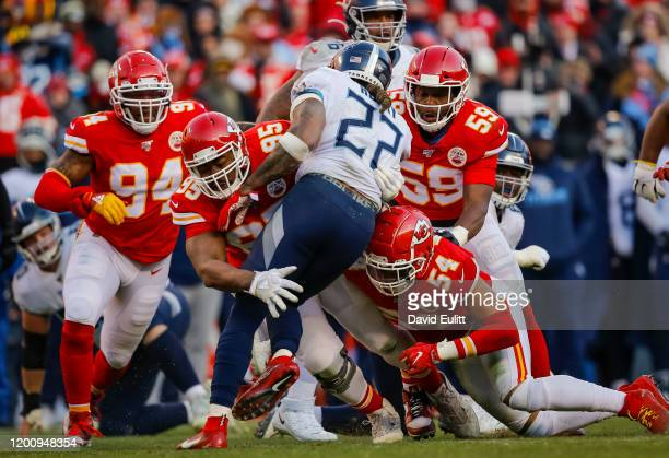 Chris Jones of the Kansas City Chiefs and Damien Wilson of the Kansas City Chiefs stop Derrick Henry of the Tennessee Titans in the second quarter...