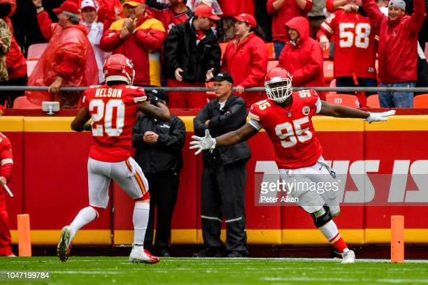 Chris Jones of the Kansas City Chiefs celebrates with teammate Steven Nelson after an interception return for a touchdown during the second quarter...
