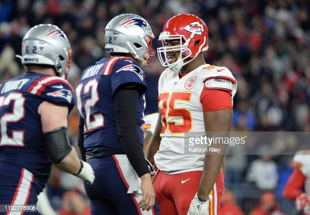 Chris Jones of the Kansas City Chiefs exchanges words with Tom Brady of the New England Patriots during the first half of the game at Gillette...