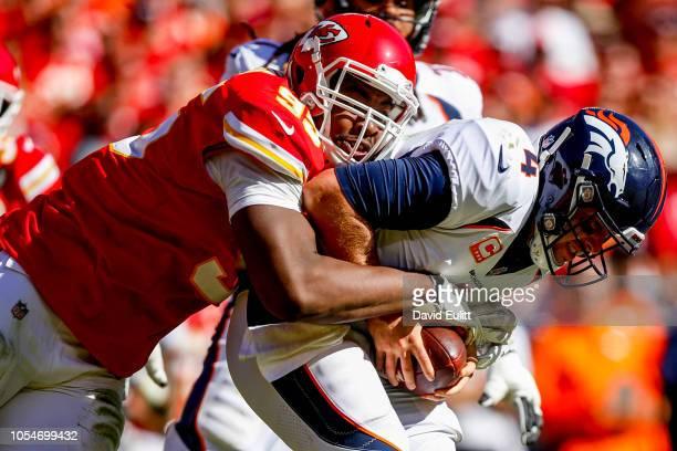 Chris Jones of the Kansas City Chiefs sacks Case Keenum of the Denver Broncos during the third quarter of the game at Arrowhead Stadium on October 28...