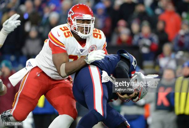 Chris Jones of the Kansas City Chiefs sacks Tom Brady of the New England Patriots during the third quarter in the game at Gillette Stadium on...