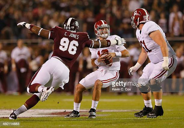 Chris Jones of the Mississippi State Bulldogs sacks AJ McCarron of the Alabama Crimson Tide at Davis Wade Stadium on November 16 2013 in Starkville...