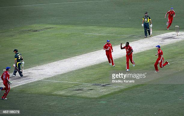 Chris Jordan of England and team mates celebrate after taking the wicket of David Warner of Australia during the second game of the One Day...