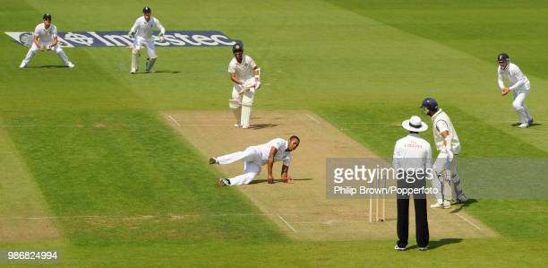Chris Jordan of England catches India's Ajinkya Rahane for 0 off his own bowling during the 5th Test match between England and India at The Oval...