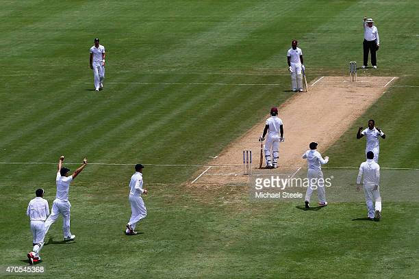 Chris Jordan of England celebrates after capturing the wicket of Devon Smith of West Indies during day one of the 2nd Test match between West Indies...