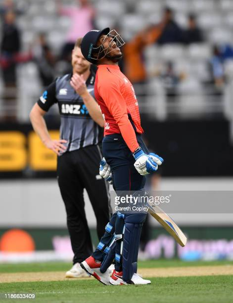 Chris Jordan of England celebrates after hitting the final ball for four runs during game five of the Twenty20 International series between New...