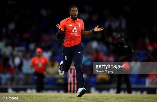 Chris Jordan of England celebrates dismissing Darren Bravo of the West Indies during the 2nd Twenty20 International match between England and West...