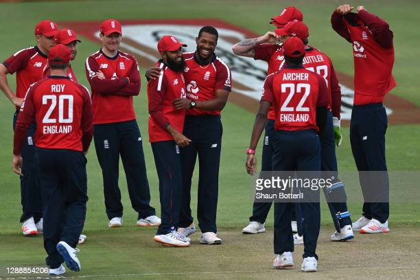Chris Jordan of England celebrates with Adil Rashid after dismissing Quinton de Kock of South Africa during the 3rd Twenty20 International between...