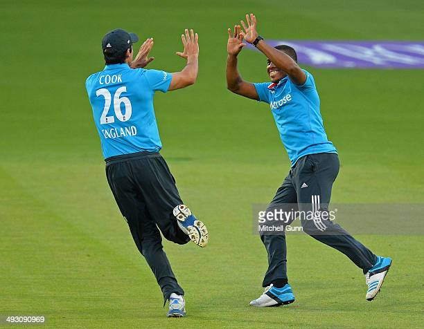 Chris Jordan of England celebrates with Alastair Cook of England the wicket of Tillakaratne Dilshan of Sri Lanka during the England v Sri Lanka first...
