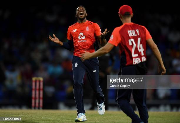 Chris Jordan of England celebrates with Joe Denly after dismissing Fabian Allen of the West Indies during the 2nd Twenty20 International match...