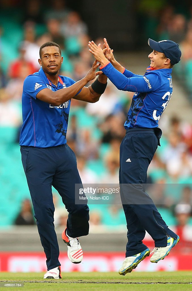Chris Jordan of England celebrates with team mates after claiming the wicket of Afsar Zazai of Afghanistan during the 2015 Cricket World Cup match between England and Afghanistan at Sydney Cricket Ground on March 13, 2015 in Sydney, Australia.