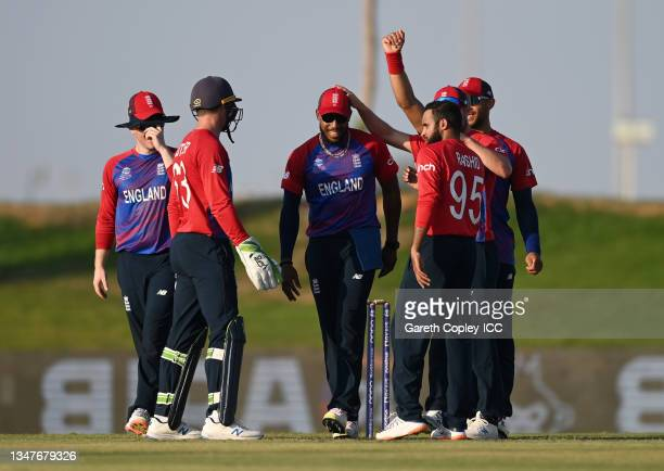 Chris Jordan of England celebrates with teammates after catching out Kyle Jamieson of New Zealand during the England and New Zealand warm Up Match...