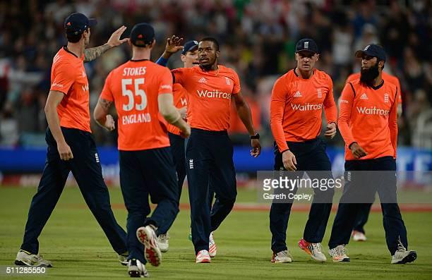Chris Jordan of England celebrates with teammates after dismissing David Miller of South Africa during the 1st KFC T20 International match between...