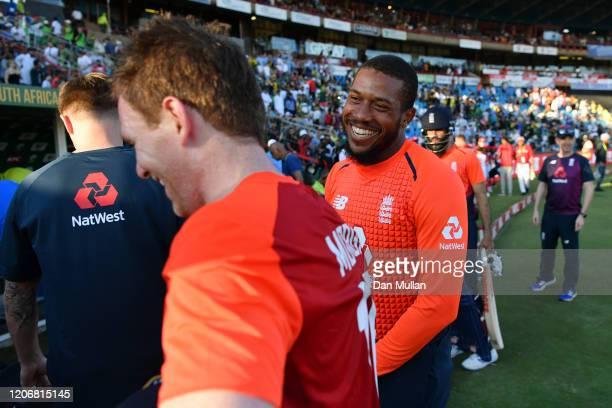 Chris Jordan of England congratulates Eoin Morgan of England following their sides victory during the Third T20 International match between South...