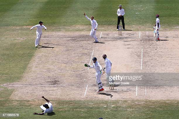 Chris Jordan of England takes a catch at first slip to claim the wicket of Shivnarine Chanderpaul of West Indies off the bowling of Joe Root during...