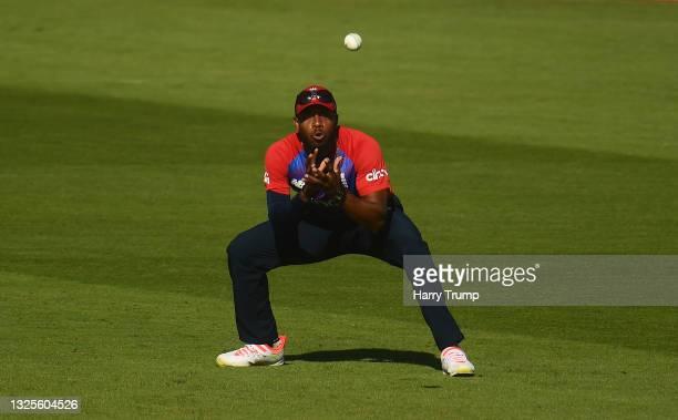 Chris Jordan of England takes a catch to dismiss Niroshan Dickwella of Sri Lanka during the T20 International Series Third T20I match between England...