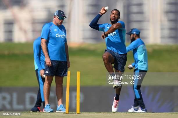 Chris Jordan of England warms up watched by coach Chris Silverwood ahead of the England and New Zealand warm Up Match prior to the ICC Men's T20...
