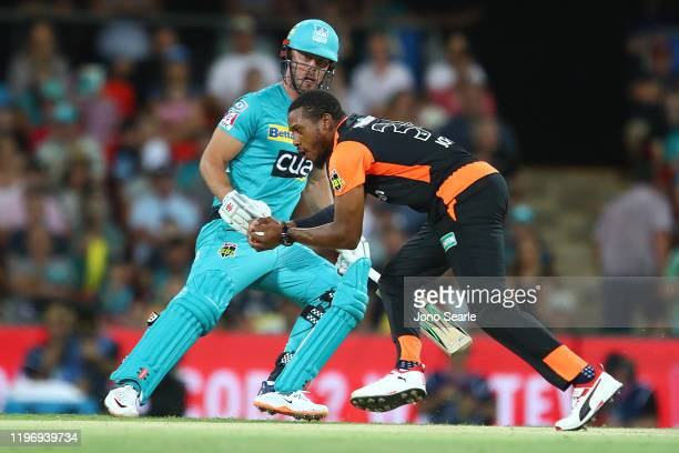 Chris Jordan of Perth takes a catch of his own bowling during the Big Bash League match between the Brisbane Heat and the Perth Scorchers at Metricon...